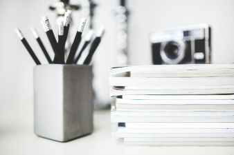 stack of magazines pencils in gray cup